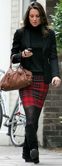 I love the fact that she wears plaid skirts with tights and boots because I do too. :-)