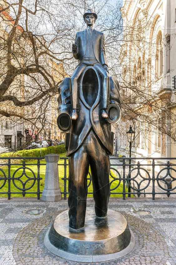 Bronze statue of Franz Kafka, Prague Photos PRAGUE, CZECH REPUBLIC - APRIL 28, 2016: Jaroslav Rona's bronze statue of Franz Kafka in Prague, Cze by Photocreo Michal Bednarek