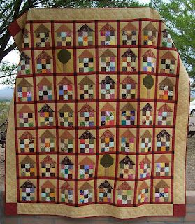 This quilt pattern came from a folk art quilting book.  Simple nine patch with a flying geese roof.  Colleen's Quilting Journey