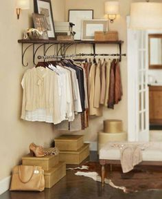 Pretty shelf supports above the bars add additional storage space that look less like a closet and more like decoration