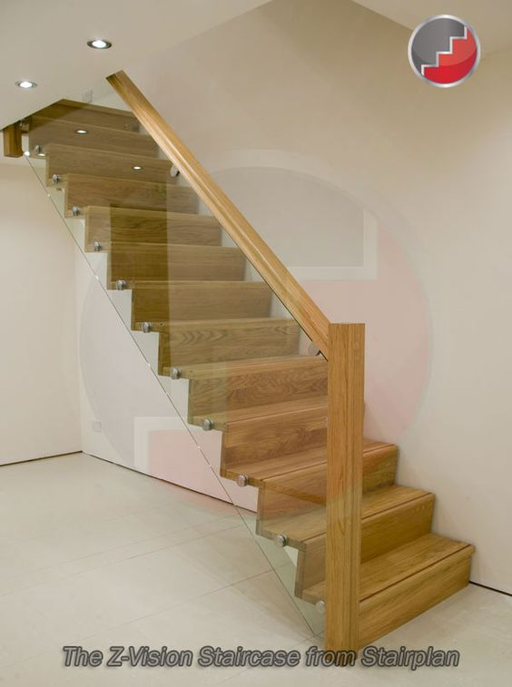 Contemporary oak staircase with glass railing system    Z-Vision Staircase from Stairplan