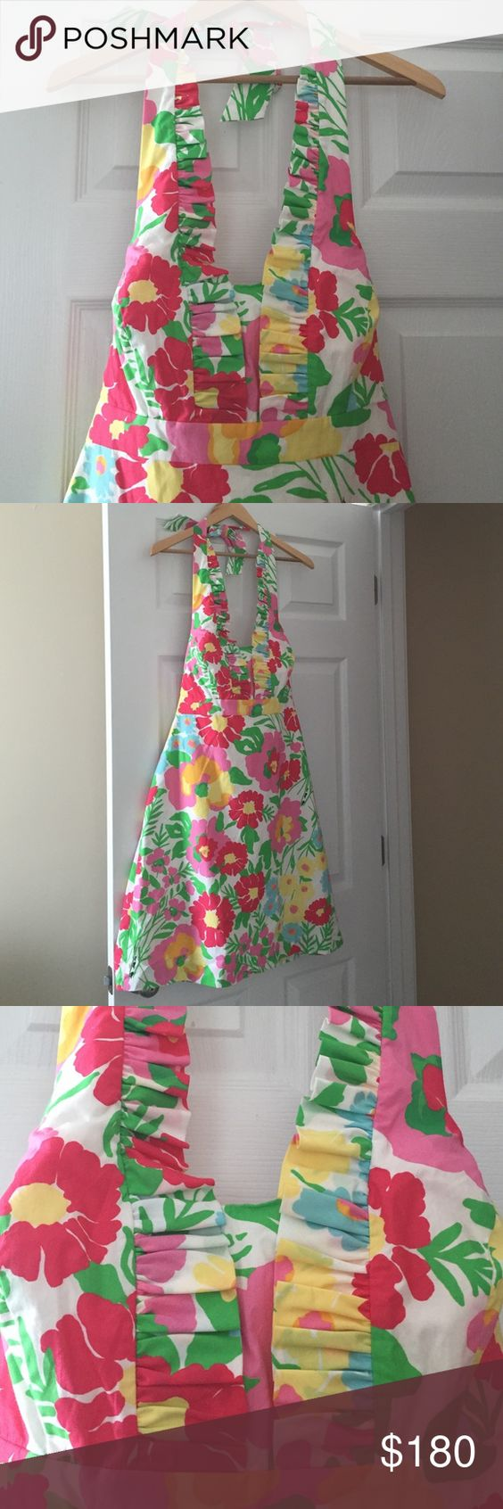 Lilly halter dress Fun flower print Lilly halter dress. This is a structured halter with full lining and back hidden zipper. Ruffle detail on the front chest area up to the halter tie. Never worn. Size 10 but fits 6-10 Lilly Pulitzer Dresses Mini