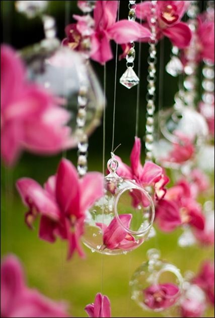 hanging ball vases with strands of crystals in between for the arch (or just the ball vases)