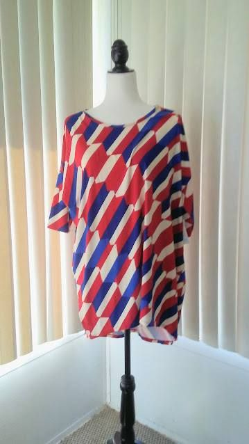 If this were my size, I'd totally rock this American styled LulaRoe Irma shirt for Labor Day!!   See more at: facebook.com/groups/LularoeDeniseDreyer