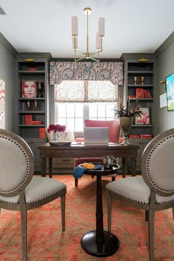 Sophisticated textures and color choices keep the eye roaming in this elegant home office, which is conveniently located on the second floor landing.