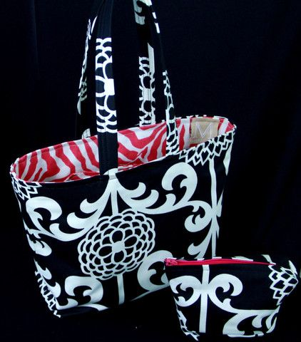 This great bucket bag is awesome! Both tote and matching cosmetic bag for $52.00. Free shipping!