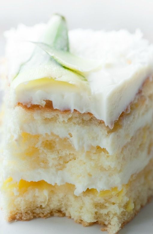 ♔ Recipe for Pina Colada Cake - Pina Colada Pineapple Cake with Coconut . Fluffy and soft sponge cake Drizzled in rum, coconut milk and pineapple mousse with chunks of pineapple. Sprinkled with coconut, with an option of kid friendly too!