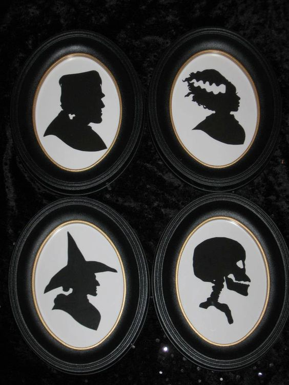 ghoulish gallery halloween silhouette set. $88.00 via etsy.  these would be an easy diy and the silhouette style is always great for simple and understated decor