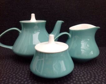 Poole Pottery Tea Pot, milk and lidded sugar dish all in fantastic condition.