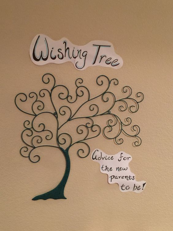 Filled the tree by hanging bookmarks with advice from the attendees for new mom!