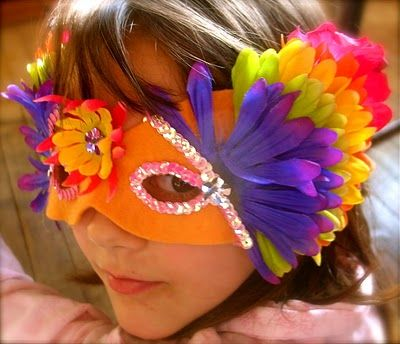 Combining this felt mask idea with an earlier one I saw that shows you how to make handprint masks. Happy Mardi Gras!!
