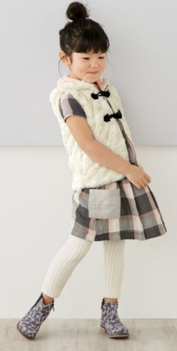 faux fur hooded vest paired with a cotton plaid shift dress