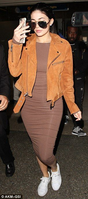 Kylie Jenner flashes diamond sparkler as touches down in LA after leaving her beau in Europe | Daily Mail Online