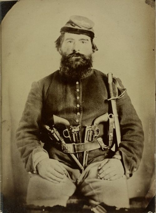 It was commonplace for cavalry soldiers to carry multiple weapons, especially revolvers. Most revolvers of the day were breech loaders that required a soldier to put powder in, followed by a bullet, then rammed home and capped for each individual chamber and revolvers could have 6 or more chambers. Obviously in the middle of a gunfight this process would leave the soldier vulnerable and so they just carried multiple pistols or cylinders so as to always have something loaded.