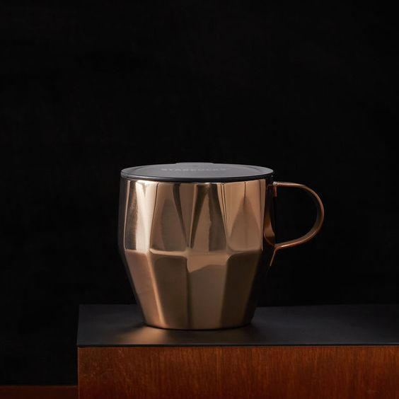 A Stainless Steel Desktop Style Coffee Mug With A Cool