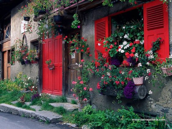 Flowered houses in village of Le Tour, Chamonix Valley. France.