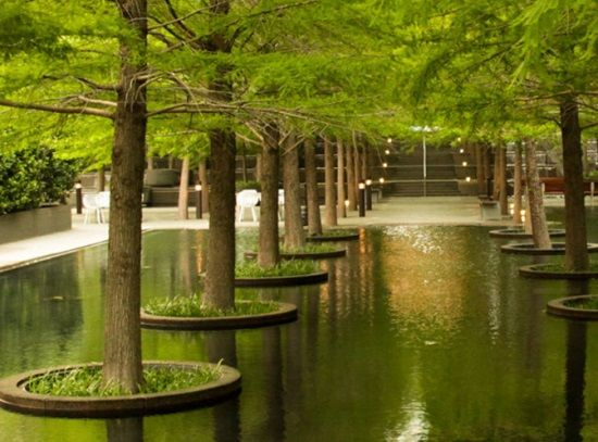 fountain place in texas uses landscape lighting generously