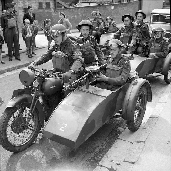 Home Guard soldiers on motorcycle sidecar combinations fitted with Lewis guns during an exercise near Exeter, 10 August 1941.