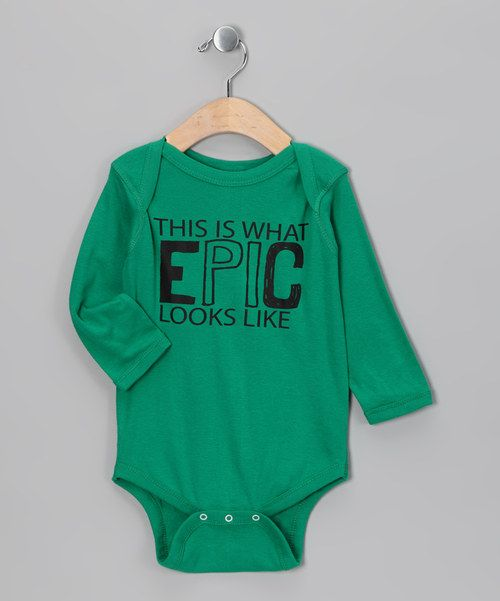 Celebrate the glory of geekdom with a fun bodysuit. This soft, stretchy number features a lap neck and snap closures for smart changing.