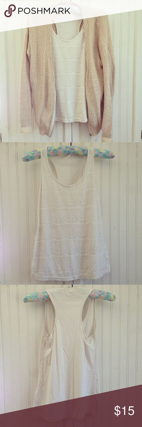 F21 Cream Scalloped Lace Racerback Tank This cream colored racerback tank by Forever 21 features a beautiful scalloped lace layover. This delicate print looks girly & gorgeous in any outfit! The armpit area is slightly stained on both sides, but it's hardly noticeable. Otherwise no flaws. Forever 21 Tops Tank Tops
