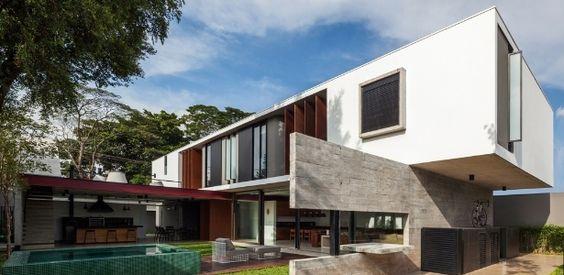 Parede de concreto aparente sustenta bloco elevado em casa moderna - Casa e Decoração - UOL Mulher