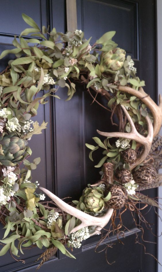 Wreath with antlers --Would be great Fall wreath if you added some hints of orange/rust and made a burlap bow :)