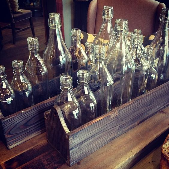 10-bottle boxed center piece. A nice touch to a rustic style look.