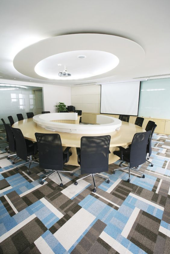 office, meeting room, blue, black, white, gray, ceiling design, circle table, projector, rolling chairs, projector screen, office plant, interior design