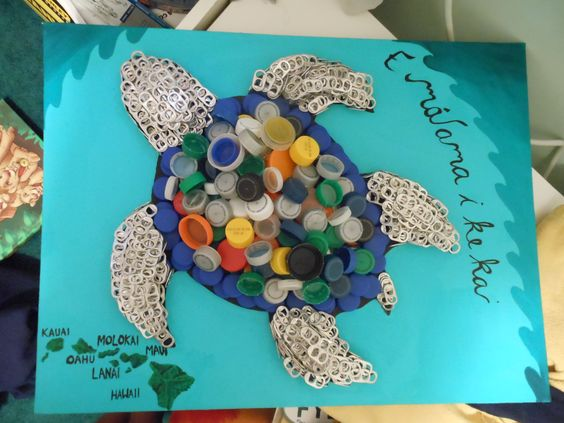 Create a recycled bottle cap sea turtle. Use caps for the shell and soda tabs for the head and flippers.