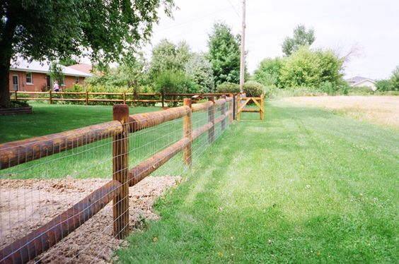 Log Pole Fence ~ Log rail and welded wire fence split fencing