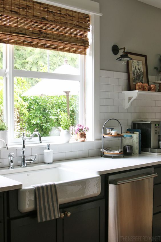 Exactly! White subway tile backsplash, farm sink under window, dark cabinets, stainless steel, natural window coverings - The Inspired Room Kitchen - Farmhouse Sink - Summer House Tour