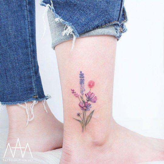 40 Colored Delicate Tattoos By Tattooist Nanci Ankle Tattoo Designs Delicate Tattoo Bouquet Tattoo