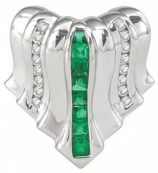 This is a stunning 18k white gold slide pendant. The pendant features vivid green square cut emeralds that weigh approximately 0.40ct. The emeralds are accentuated by sparkling round cut diamonds that weigh approximately 0.30ct. The color of the diamonds is H with VS clarity. The pendant measures 24mm by 22mm and weighs 8.8 grams. The pendant is stamped 750 18K.