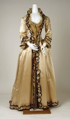 "Tea gown, ca. 1880:  ""One does not go out to dine in a tea-gown except in the house of a member of one's family or a most intimate friend. One would wear a tea-gown in one's own house in receiving a guest to whose house one would wear a dinner dress."" == Emily Post, Etiquette, 1922."