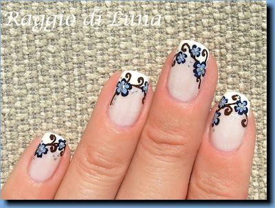 french manicure with delicate blue flowers