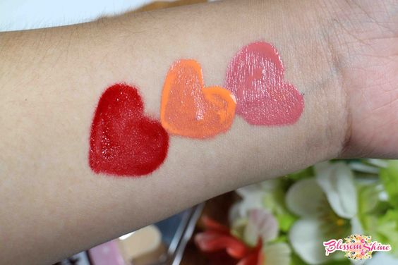 Hand swatch of La Tulipe Liptint from Top - Bottom: Cotton Candy, Peach Soda & Red Velvent