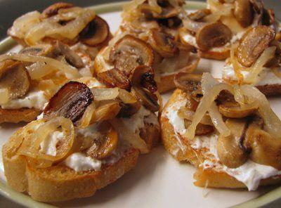 /> Caramelized onion & mushroom crostini with feta & roasted garlic spread.
