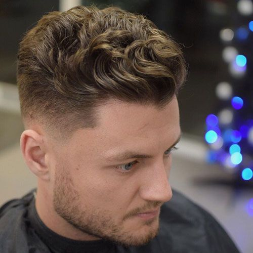 A Low Skin Fade And A Short Wavy Slick Back Is A Great Modern Look For Both Thin And Thick Hair In 2020 Haircuts For Wavy Hair Wavy Hair Men Thick