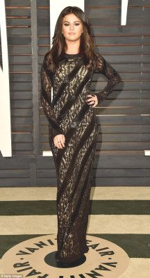 Selena Gomez goes for gothic glamour in black crochet gown February 24, 2015