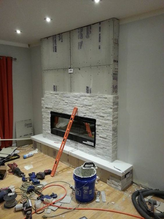 Everything started coming together when they added beautiful white-gray stones to the hearth.