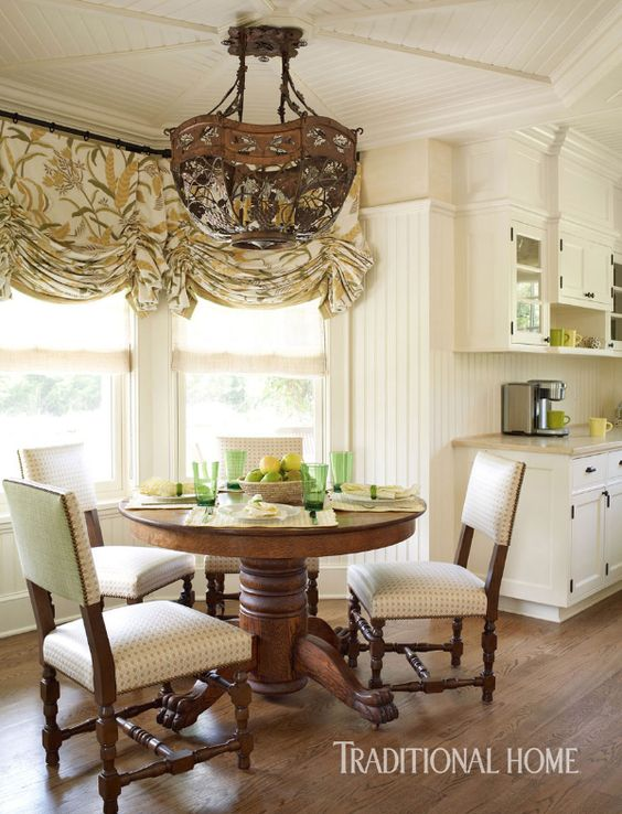 A beamed and wood-plank ceiling and bay window define the cozy dining area. - Photo: Tria Giovan / Design: Douglas Graneto