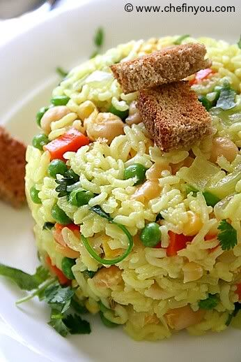 Chickpeas Rice  This simple chickpeas and rice is not only colorful and vibrant but low in calories and nutritious too. Jiffy to make - takes under 15 minutes & appetizing.