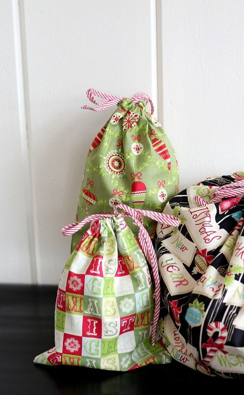 Easy-to-sew Reusable Fabric Gift Bags from The Cottage Mama. (Little toy and parts pieces of gifts  too often get lost when wrapping paper is gathered up and thrown away):