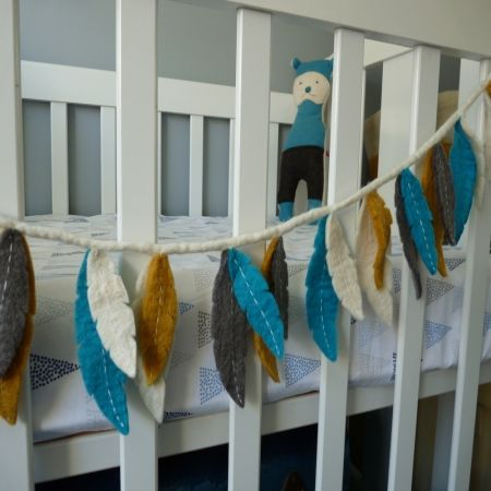 Felt feather garland - use different colors and hang up with fairy lights. LOVE