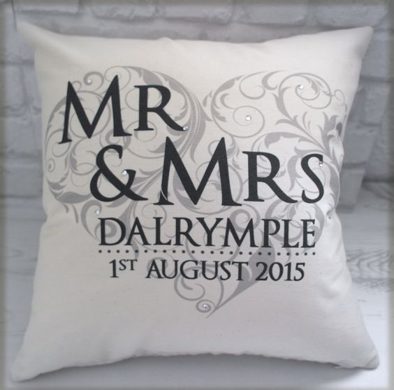 Mr & Mrs Cushion - Elegant design which incorporates the couples married name, wedding date and option venue. This is available with any colour writing making it the perfect gift to complement the wedding colours or home. These also make a great pillow to carry the wedding rings on. This design is also available on an art block or in a frame