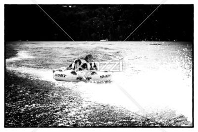 image of kids enjoying in boat. - Black and white shot of small kids enjoying in inflatable boat.