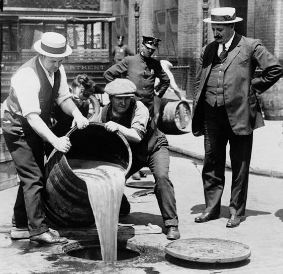 Prohibition era disposal of illegal alcohol confiscated by the government. Alcohol played a major role in Fitzgerald's life; he was an alcoholic and likely died so young due to the effect his addiction had on his health.