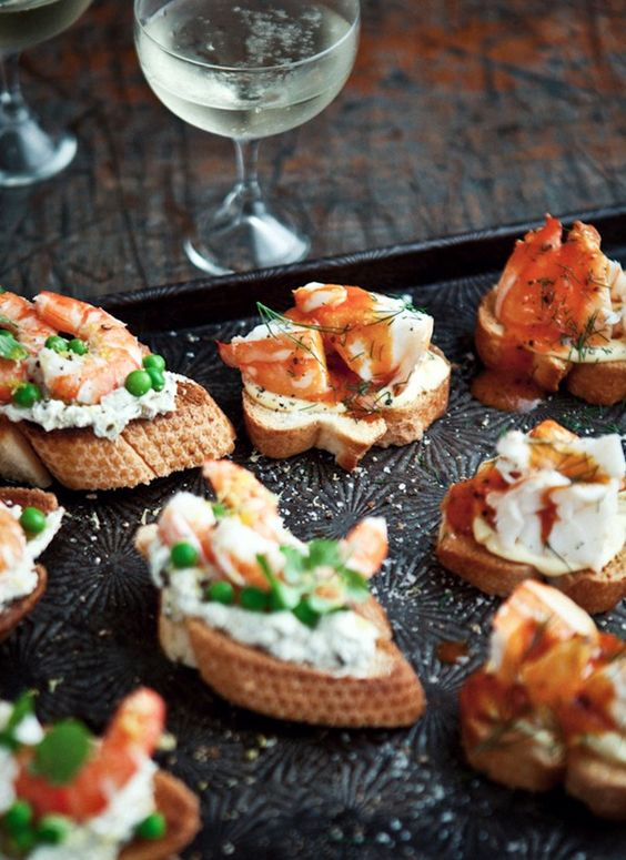 Lobster crostini with buttery tomato and Champagne sauce, fresh dill