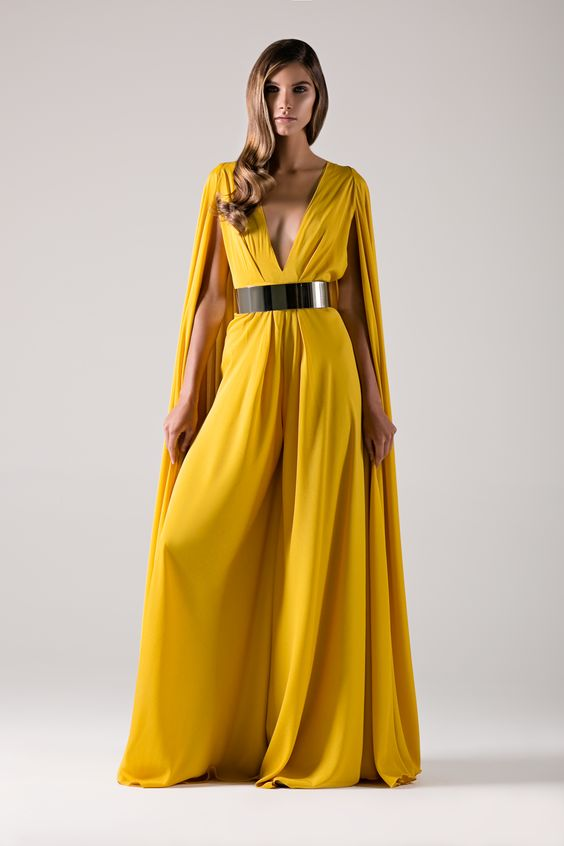 Golden yellow cape jumpsuit with plunge neck wide leg.-Michael Costello US Size Chart- Made true to size- When choosing height, include the inchesof yourheels- Dry clean only- Belt not included