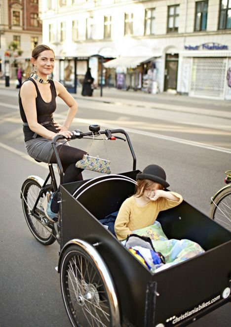Copenhagen transport....Love the fashion statement (and that bag!) whilst riding a bike with children. Fabulous!: